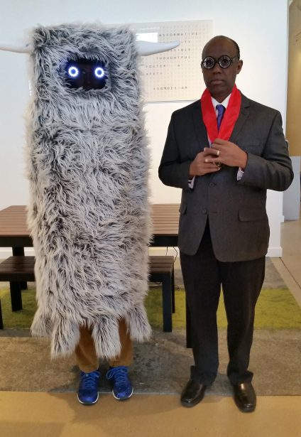 "Daniel Gonzales wowed everyone with what they called the ""Fuzzy Space Worm""…but he has a much more intelligent explanation of it as a character from Meow Wolf shown in a Santa Fe art exhibit-wow! Daniel is pictured with Cornell Allen as Corbusier."