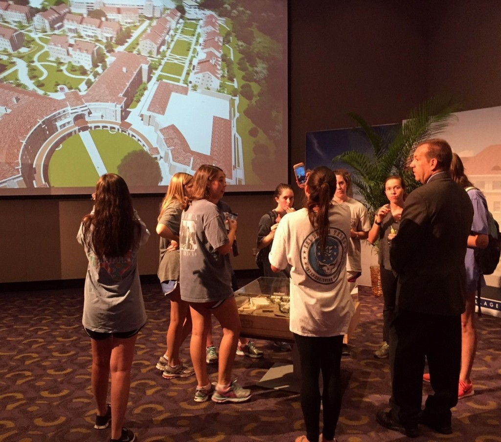 TCU Director of Housing & Residence Life Craig Allen discusses the project with students during the TCU: The Next Chapter interactive gallery exhibit.
